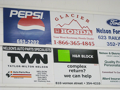Sponsor ads on wallboards at the curling rink